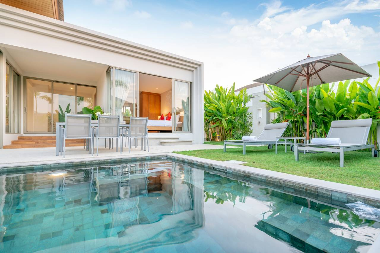 Exterior of home with swimming pool
