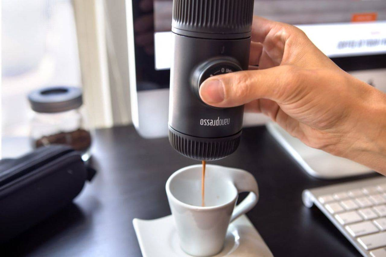 A man putting espresso in his cup