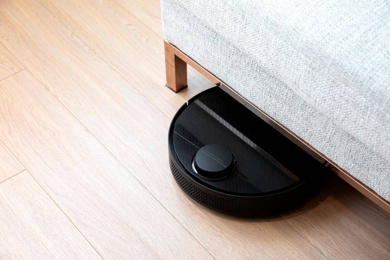 Robot vacuum cleaning under the couch